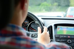 In Car Distractions from Infotainment and Auto Accident Liability